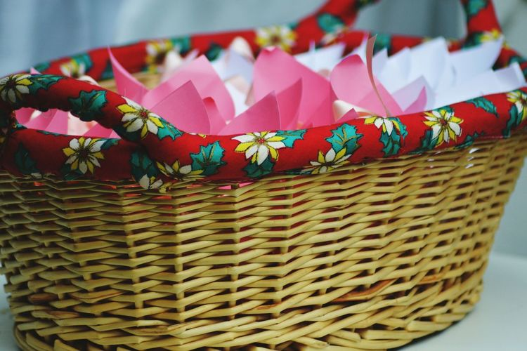 Close-up of multi colored flowers in wicker basket