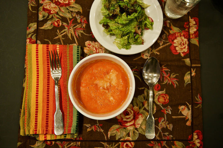 Vegetarian dinner of soup and salad. Bowl Dinner Directly Above Eating Utensil Food Freshness Healthy Eating High Angle View Indoors  No People Plate Ready-to-eat Salad Salad Bowl Savory Food Side Dish Soup Soup And Salad Spoon Table Tomato Soup Vegetarian Food