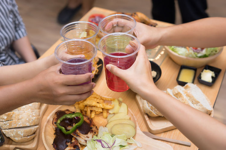 Adult Celebratory Toast Drink Drinking Glass Food Food And Drink Freshness Friendship Glass Group Of People Hand Holding Household Equipment Human Body Part Human Hand Ready-to-eat Real People Refreshment Table Togetherness Women