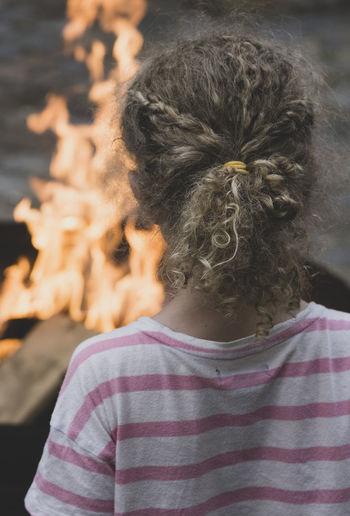 Rear View Of Girl Looking At Bonfire