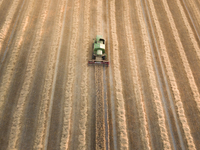 Aerial view of combine harvester on agriculture landscape