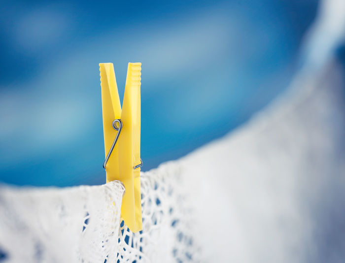 Yellow clothespin on clothesline