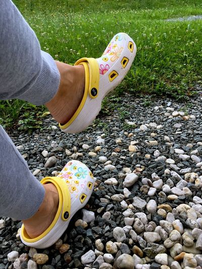 Human Body Part Low Section Human Leg Shoe One Person Day Real People Canvas Shoe Outdoors People Grass One Woman Only Adults Only Close-up Adult Crocs Crocs 😎 Garden Garden Shoes Plastic Shoes FreeTime Free Time Relaxing Casual Summertime