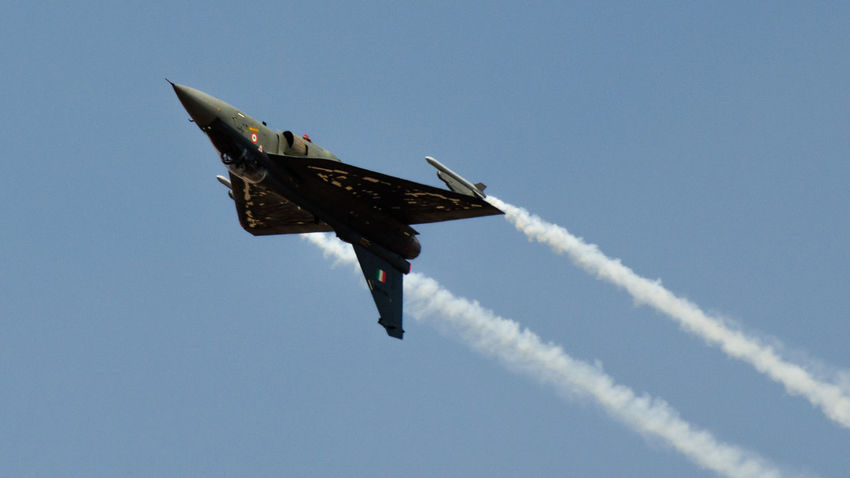 HAL Tejas Indian Air Force IAF Tejas Lac Airplane Transportation Military Airplane Air Force Military Mode Of Transport Blue No People Motion Day Speed Mid-air Clear Sky Outdoors Flying Air Vehicle Airshow Vapor Trail Fighter Plane Nature Low Angle View Aerospace Industry Sky
