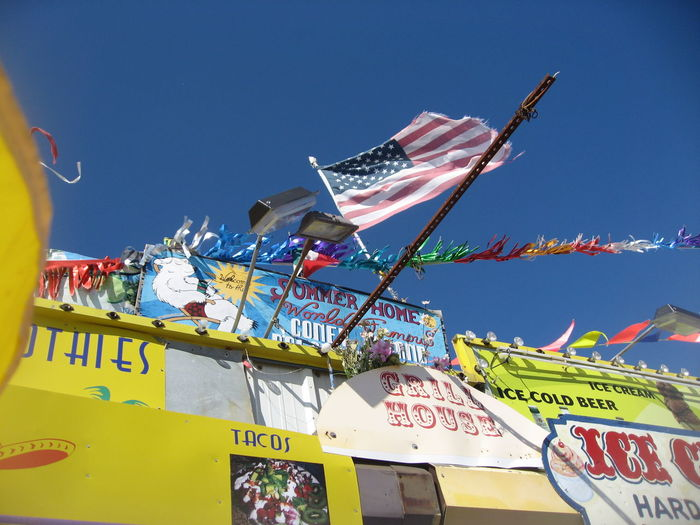 #Americana #americanflag #coneyisland #kitchamericanflag Blue Clothesline Day Information Information Sign Low Angle View Multi Colored No People Outdoors Pole Sky Variation