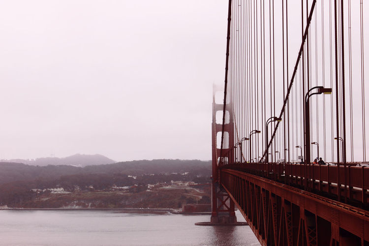 Architecture Bridge Bridge - Man Made Structure Built Structure Cable-stayed Bridge Clear Sky Connection Engineering Famous Place Foggy Morning Golden Gate Bridge International Landmark Mountain Outdoors River Steel Cable Suspension Bridge Tourism Travel Destinations Waterfront