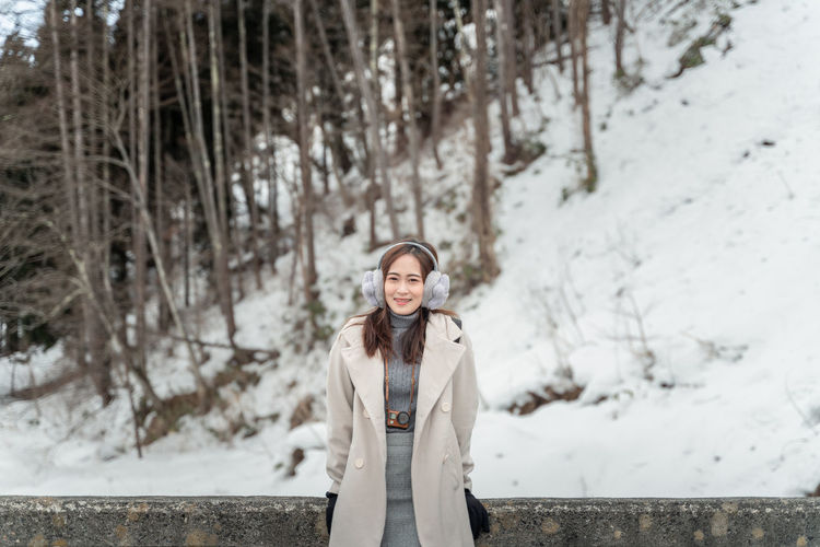 Winter Snow Looking At Camera Cold Temperature One Person Portrait Young Adult Front View Standing Young Women Warm Clothing Clothing Women Real People Lifestyles Leisure Activity Focus On Foreground Beauty Smiling Hair Beautiful Woman Hairstyle Outdoors
