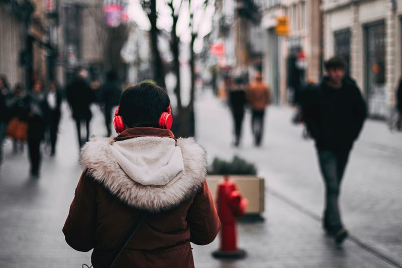 Warm Clothing Winter Cold Temperature Rear View Real People Red Outdoors City One Person Standing Lifestyles Day Men Architecture People Adults Only Adult Music Earphones Listening To Music Walking Walk City Jacket Red