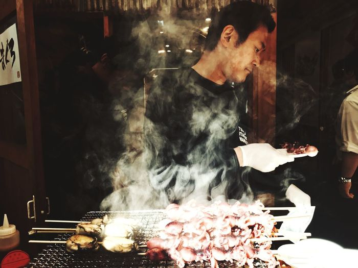 The Legend Smoke - Physical Structure Food Food And Drink Real People Men Meat Heat - Temperature Freshness Burning Smoking - Activity Unhealthy Eating Indoors  Steam One Person Barbecue Night Fast Food Ready-to-eat Close-up People