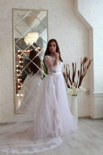 One Person Wedding Newlywed Real People Women Bride Lifestyles Full Length Life Events Wedding Dress Young Adult Celebration Young Women Smiling Looking At Camera Beautiful Woman Leisure Activity Adult Standing Happiness Fashion Flooring