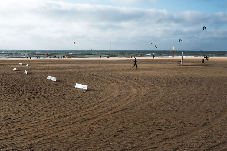 Beach with kite surfers on background Beach Beachphotography Beauty In Nature Cloud - Sky Day Horizon Over Water Kitesurfing Nature Netherlands Outdoors Real People S Sand Scenics Sea Shore Sky The Hague Tranquility Travel Travel Destinations Vacations Water Wave