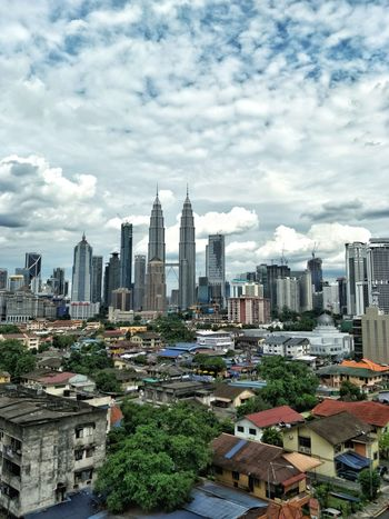Sky Cloud - Sky Architecture Skyscraper Building Exterior Cityscape City Modern Built Structure No People Urban Skyline Outdoors Day Tree KLCC Twin Towers Kuala Lumpur Malaysia Independence Day