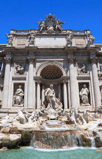 Low Angle View Of Statues At Trevi Fountain