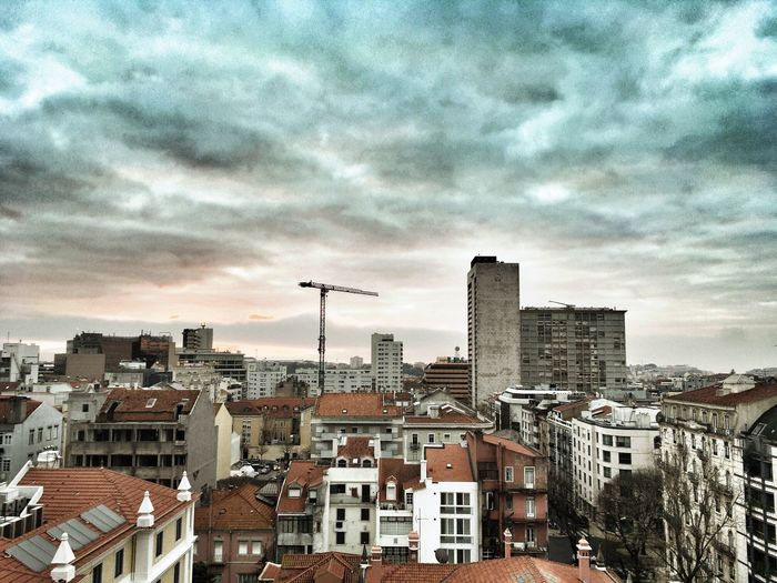 Dawn of a city - Lisbon, Portugal 2017 Building Exterior Architecture Built Structure City Cityscape Sky Residential Building Cloud - Sky Residential District Crowded House Outdoors Roof City Life Day Dawn Of A New Day Dawn EyeEmNewHere Flying High