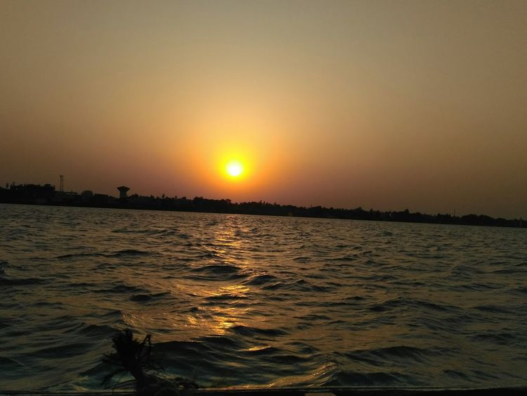Sunset Sun Water Reflection Outdoors Sky Nature Tourism Tranquil Scene No People Beauty In Nature Gold Colored Vacations Tranquility Landscape Travel Destinations