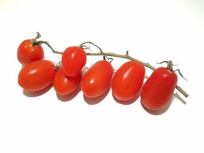 Sweet grape tomatoes on the vine Spring Summer Grape Tomatoes Gardening Pick Choose Healthy Eating Salad White Background Studio Shot Red Tomato Raw Food Close-up Food And Drink Ripe Juicy Vitamin Cherry Farmer Market Antioxidant