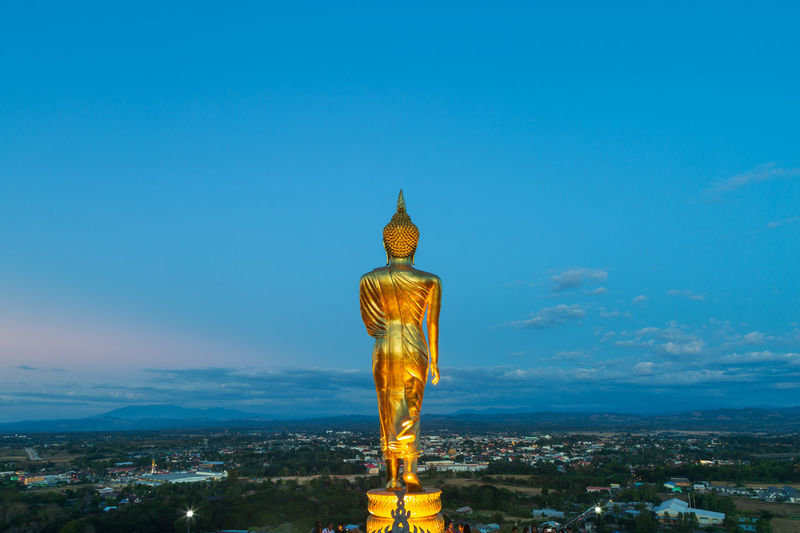Beautiful Buddha standing statue See look like looking at the town Twilight Town Cloudy Famous Golden Building Spirituality Religious  Country Historical Building Old Hill Standing Sunrise Image Traditional Worship Tourism Thailand Northern Faith Serene