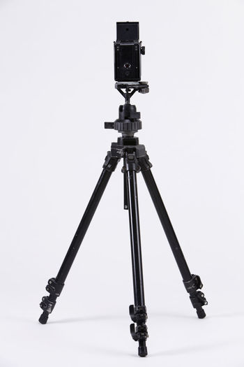 back view of the camera mounting on the tripod Camera Photography Multimedia Tripod Photograph Lens Equipment Photographic Theme Photographing Black Nobody White Background Twin Lense Medium Format Camera Old Antique Ancient Photography Themes Technology Back View Rear View Studio Shot No People Indoors  Photographic Equipment Camera - Photographic Equipment Copy Space Still Life Cut Out