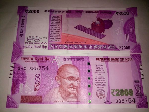 Indian two thousand rupee note 2000 Banknote Business Currency Indian Finance Finance And Economy Indian Culture  Indian Currency Indian Two Thousand Rupee Note New Paper Currency Pink Color Savings Success Two Thousand Rupee Note Wealth