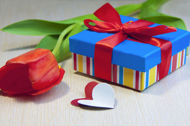Valentine Object Congratulate Blue Yellow Green Red Gift No People Flower Still Life Close-up Valentine's Day  With Love Flowers Box Heart Surprise Tulips Bow Packing Souvenir Loving Her With Love Love Copy Space Minimalism Simple