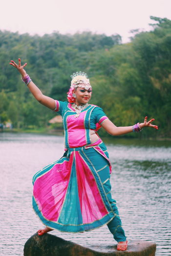 An Easy Indian dancer shows off one of her trade mark dance moves . Portrait Portrait Of A Woman Trinidad And Tobago The Modern Professional Full Length Smiling Lake Arts Culture And Entertainment Skill  Portrait Water Dancer Dancing Traditional Dancing Posing Traditional Festival Traditional Clothing Festival Diwali Sari International Women's Day 2019