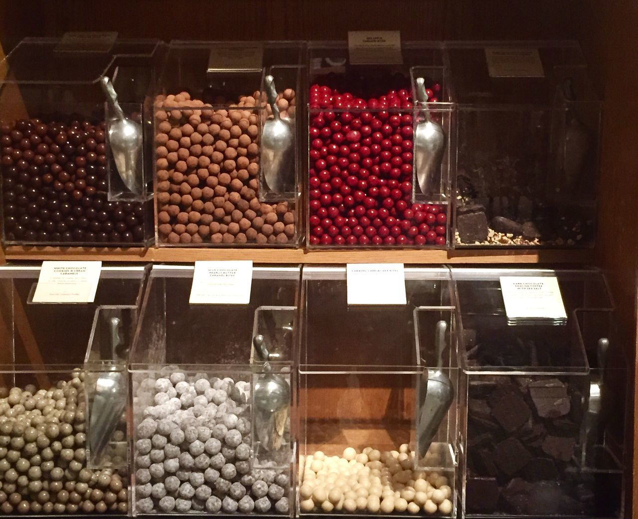 food and drink, variation, for sale, food, abundance, choice, large group of objects, indoors, retail, no people, freshness, nut - food, candy, dried fruit, healthy eating, sweet food, price tag, coffee bean, day, close-up