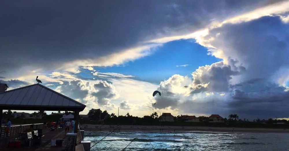 Hole in the sky Hole In The Sky Clouds And Sky Cloudscape Beach Photography Beach Life Parasail Florida Life
