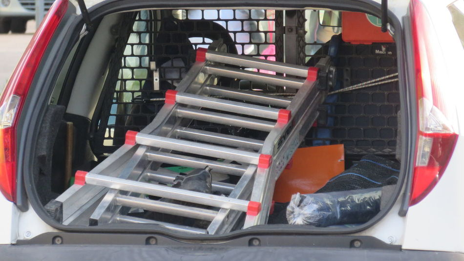 ladder and utensils in machine service CarService Close-up Day Ladder Land Vehicle Machine Part Machinery Mode Of Transport Modern No People Part Of Repairs Stationary Technician Tools Truck Utility