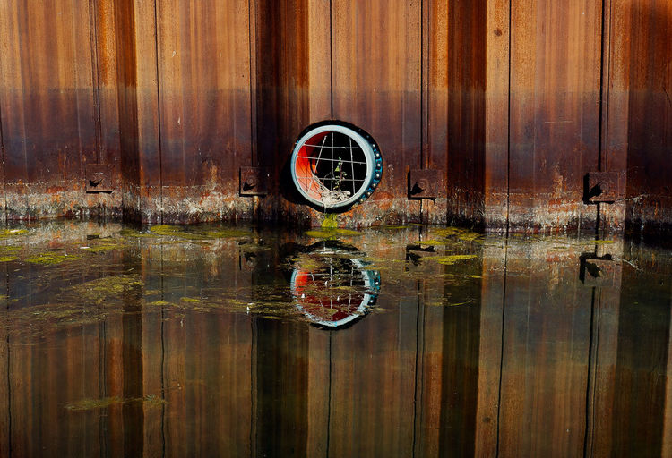 Digital composite image of wooden post with reflection