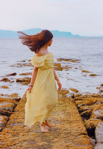 Creatiative Photography Floer Yellow Tranquil Scene Tranquility Sea Water Beach One Person Land Leisure Activity Women Lifestyles Clothing Beauty In Nature Adult Scenics - Nature Real People Fashion Full Length Standing Horizon Over Water Nature The Fashion Photographer - 2018 EyeEm Awards