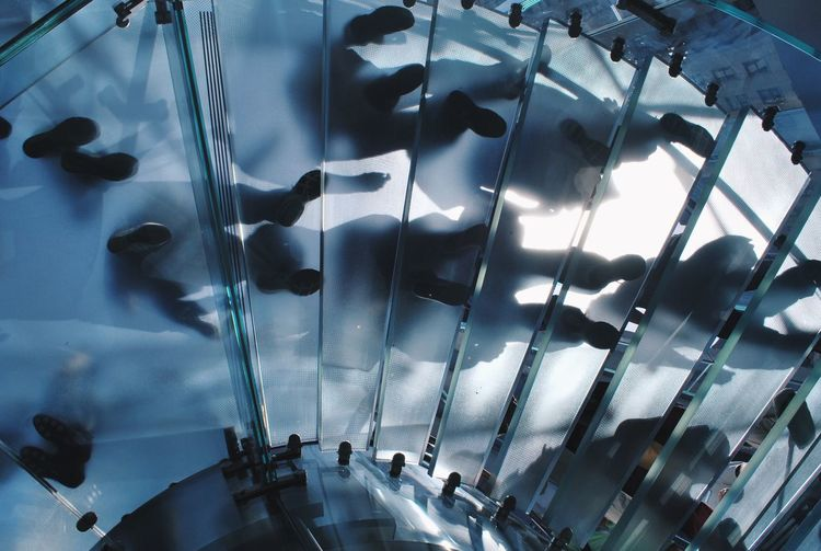 High angle view of people walking in glass