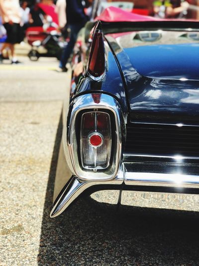 Antique Car Tail Light Tail Fin Vintage Cars Car Motor Vehicle Transportation Mode Of Transportation Land Vehicle Focus On Foreground Incidental People Street Day Sunlight Outdoors Chrome Retro Styled