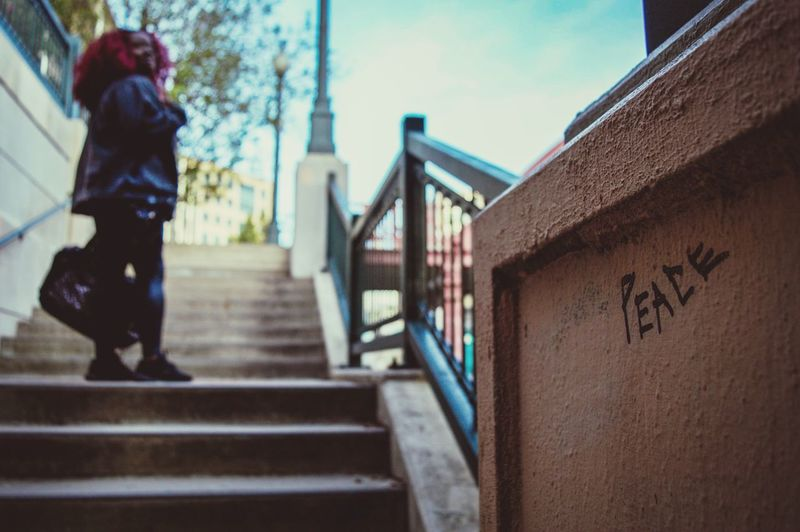 Steps Steps And Staircases Staircase Railing Walking Built Structure Stairs Architecture Full Length Day Real People Outdoors Sky One Person Climbing Hand Rail Young Adult Adult People Graffiti Written Peace Denver Colorado  Street Photography City Life
