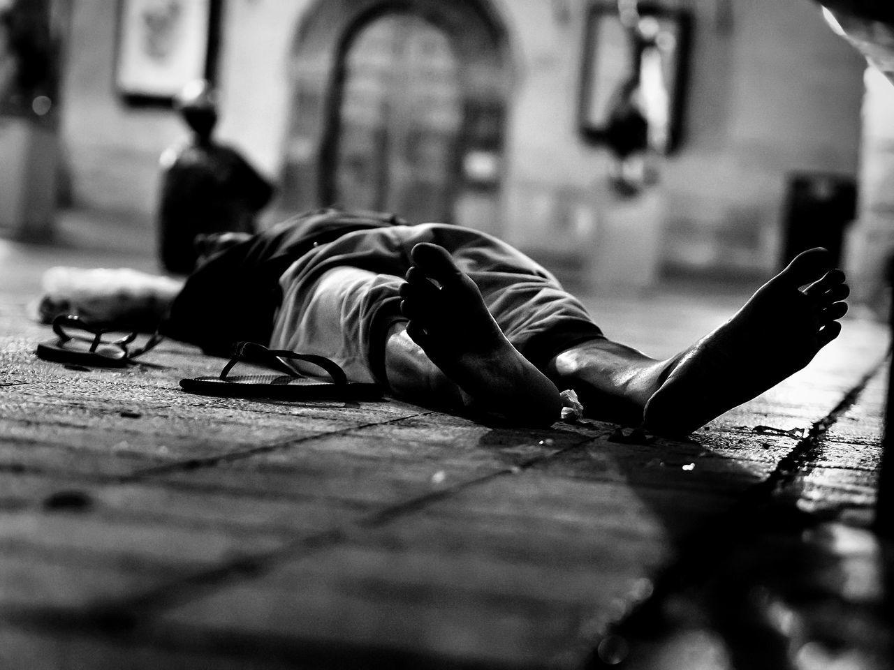 Close-Up Of Man Sleeping On Street