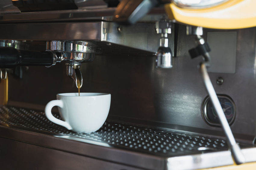 A coffee cup with coffee machine in coffee shop. Coffee Coffee Maker Coffee - Drink Cup Food And Drink Machinery Drink Mug Cafe Espresso Maker Coffee Cup Coffee Shop Indoors  Close-up Appliance No People Metal Espresso Refreshment Freshness