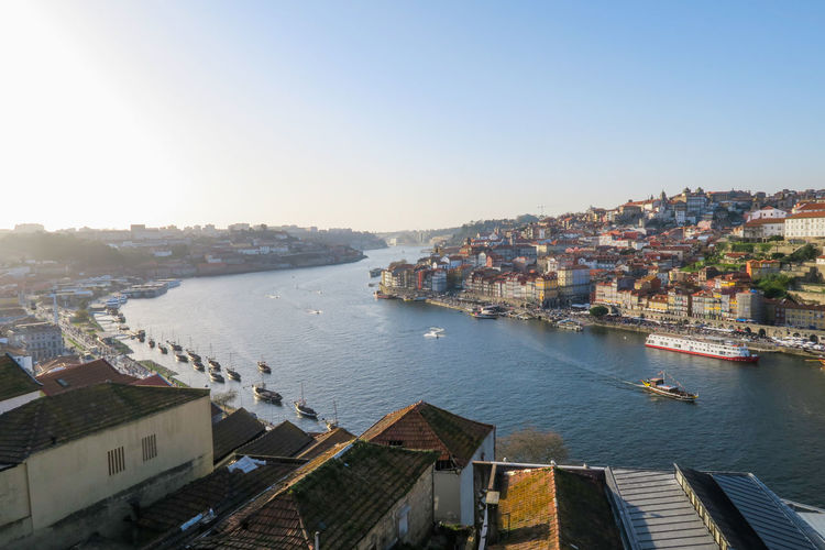 Cityscape of Douro river in Porto, portugal Porto Portugal Viewpoint Overview River Ship Sunset Febuary  Spring Blue Sky City Cityscape Water Nautical Vessel Sailing Ship Sea Urban Skyline Clear Sky
