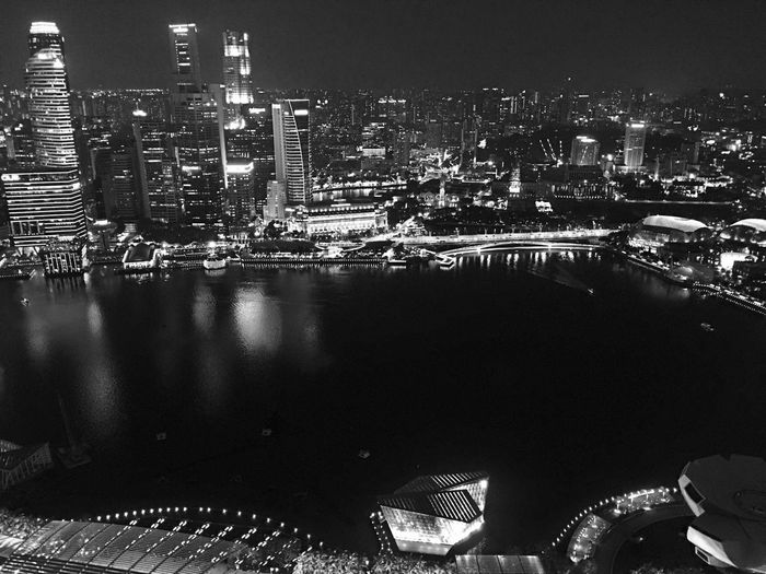 This is Singapore Building Exterior Architecture Night City Cityscape Illuminated Built Structure Skyscraper No People Outdoors Urban Skyline Water Sky Overlooking Overlooking The Sea Overlooking The City Night View Night View Of City Black And White