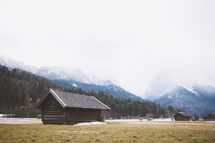 Lost In The Landscape Architecture Barn Beauty In Nature Building Exterior Built Structure Chalet Cold Temperature Day House Hut Landscape Mountain Mountain Range Nature No People Outdoors Scenics Sky Snow Tranquil Scene Tranquility Travel Destinations Tree Wood - Material