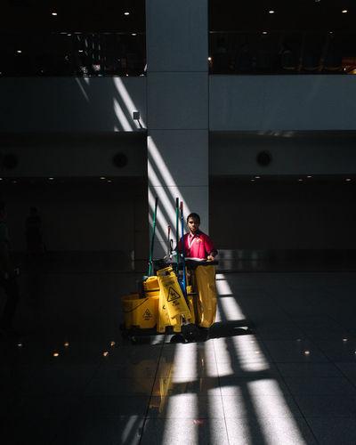 Woman standing on airport runway