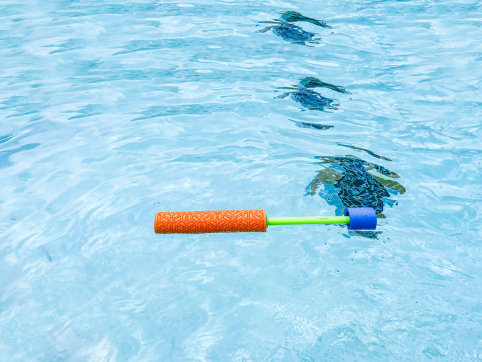 High angle view of plastic floating on swimming pool