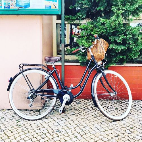 Bicycle parked against wall
