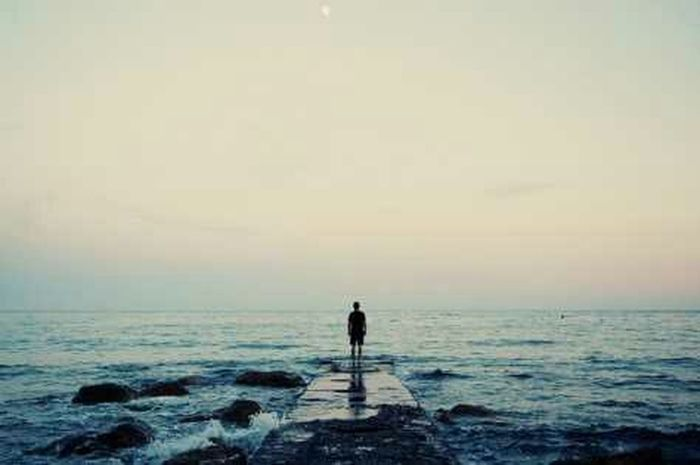 Alone at the sea Water Sea Horizon Over Water Standing Solitude Full Length Men Leisure Activity Tranquil Scene Rear View Scenics Beach Idyllic Remote Tranquility Escapism Vacations Calm Rock - Object Loneliness Myphoto MyPhotography Day Nature Softness