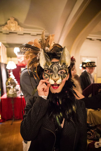 Animal Representation Art Cat Creativity Edwardian Ball Fascinating Fashion Features Front View Fun Girl Happiness Happy Human Representation Looking At Camera Masks Masquerade Portrait Feather Hat Mardi Gras Selective Focus Focus On Foreground Costume Fantastical & Magical Young Adult