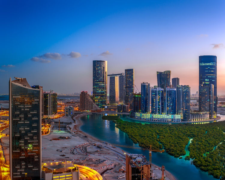 Panoramic Sunset for the Urban Development in Reem Island in Abu Dhabi City in United Arab Emirates . Architecture Blue Hour Mangrove Forest ND Filter NiSi Filters Orange Panorama Panoramic Blue Glass High Rise Building Lake Landscape Long Exposure Sky Sunset Urban Urban Skyline Water