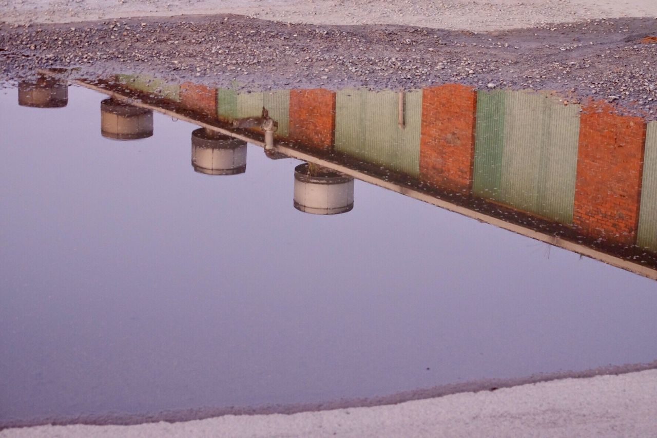 water, architecture, no people, built structure, reflection, nature, day, high angle view, building exterior, outdoors, puddle, sky, sea, wall, standing water, waterfront, clear sky, copy space, metal