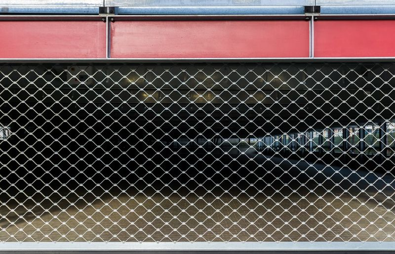 Business Closed Parking Garage Parking Lot Garage No People Pattern Built Structure Architecture Day Metal Fence Safety Chainlink Fence Boundary Barrier Absence Wall - Building Feature Security