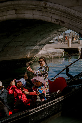 tourists ii Tourist Tourists Selfie Venice Venice, Italy Gondola - Traditional Boat Nautical Vessel Water Rowing Full Length Young Women Smiling Sitting Gondolier Portrait Rowboat Oar Moored Boat