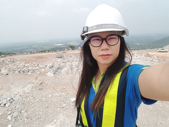 Asian woman with ppe in the quarry Asian  ASIA Quarry PPE Safety Work EyeEm Selects Young Women Portrait Eyeglasses  Sea Beach Beautiful Woman Women Sand Water Beauty