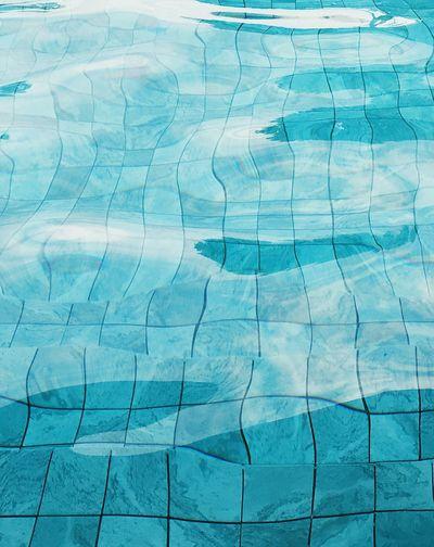 Full frame shot of swimming pool and tiled floor