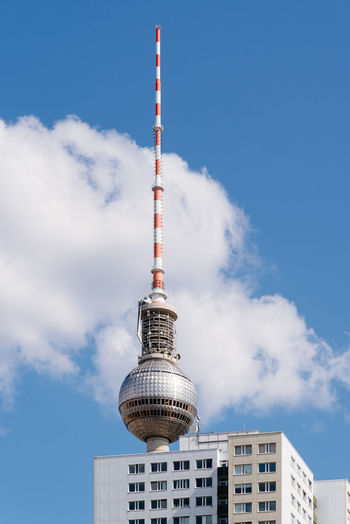 Cityscape of berlin with skyscraper and tv tower against blue sky with clouds